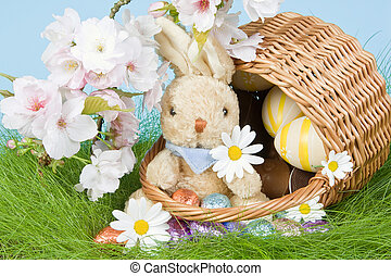 Bunny in easter basket - Easter basket with eggs and bunny...
