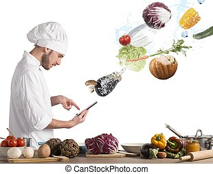 Cooking recipe from tablet - Chef reads a recipe from the...