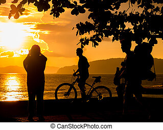 People at Sunset on the beach of Ao Nang in Krabi Thailand