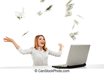 Young woman with laptop and flying money Isolated over white...