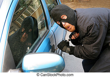 car burglary - burglar wearing a mask balaclava, car...