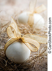 Easter eggs - White easter eggs with beautiful golden bow