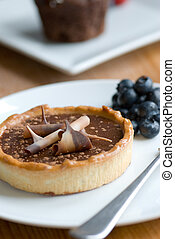 Chocolate tart - Chocolate and caramel tart with blueberries