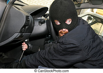 car burglary - burglar wearing a mask (balaclava), details...