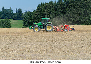 Field-engine on field with green grass and trees