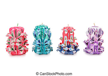 Carved candles isolated on white background