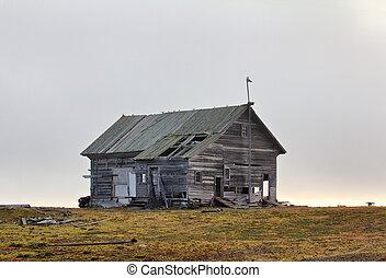 Abandoned old hunting house in tundra of Novaya Zemlya...