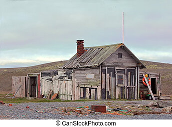 hunting cabin on shore of the Arctic ocean - old hunting...
