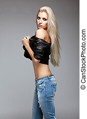 Blonde woman in ragged jeans and jacket - Blonde young woman...