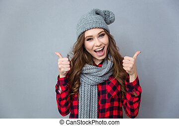 Cheerful woman showing thumbs up - Portrait of a cheerful...