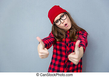 Trendy woman showing thumbs up - Portrait of a trendy woman...