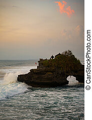sunset over hindu temple Pura Tanah Lot, Bali