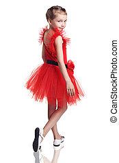 Cute little girl posing in red dress