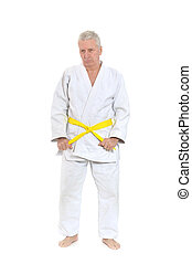 man in karate pose - Senior man in karate pose on white...