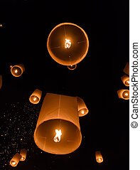 Floating lanterns in the black sky - Floating lanterns...