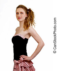 Young caucasian woman in black and pink dress