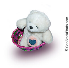 soft toy bear sitting in a basket with a heart on the paw