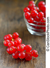 Red currants isolated on wood background