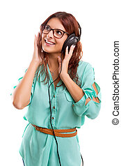 A Happy young woman listening to music