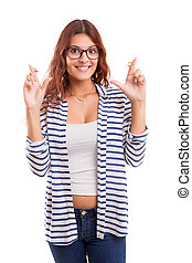 Woman with crossed fingers, isolated over a white background