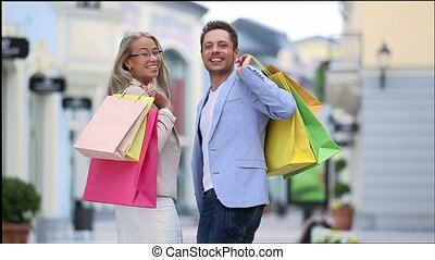 Shopping - Young couple with shopping bag