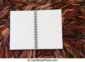 book with blank pages as copy space on fallen autumn leaves background, Top View
