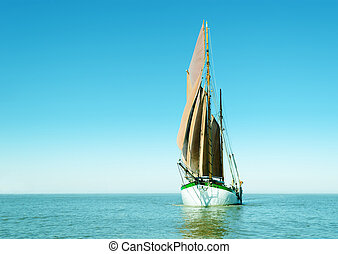 Lonely sailing ship - Traditional sailing ship alone on the...