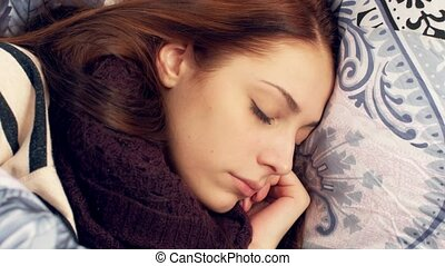 Woman sleeping in bed Tossing and turning - Cute young woman...