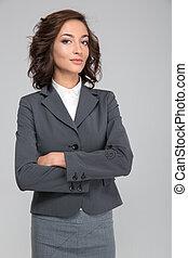 Smug young business woman with arms crossed - Smug priggish...