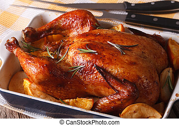 baked chicken with oranges and apples in the baking dish...