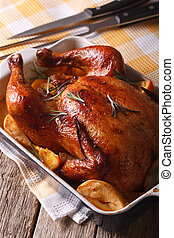 Beautiful baked chicken with oranges and apples in the...