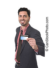 happy attractive businessman holding credit card in commerce and banking concept
