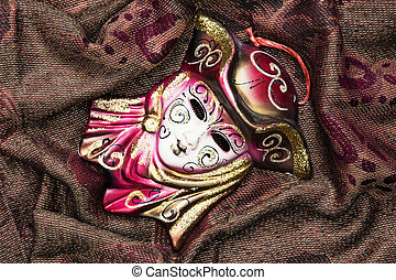 Masquerade carnival mask on the fabric background, beauty and fashion