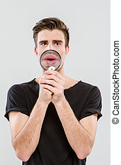 Handsome carismatic man using magnifying glass - Handsome...