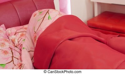 Woman sleeping in pink bed Tossing and turning - Cute young...