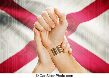 Barcode ID number on wrist and USA states flags on background - Alabama