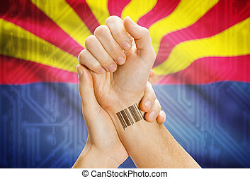 Barcode ID number on wrist and USA states flags on background - Arizona