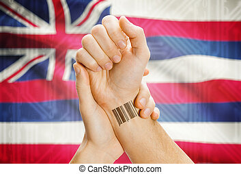 Barcode ID number on wrist and USA states flags on background - Hawaii