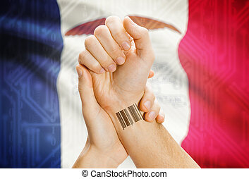Barcode ID number on wrist and USA states flags on background - Iowa