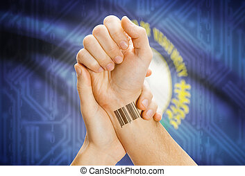 Barcode ID number on wrist and USA states flags on background - Kentucky