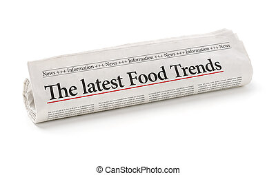 Rolled newspaper with the headline The latest Food Trends