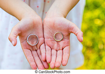 Girl Holding Wedding Rings - Young girl holding the bride...