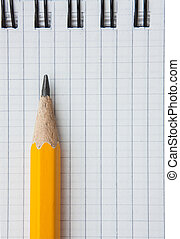 Lead pencil and notebook on white background