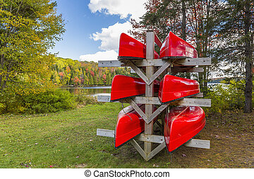 Red Canoes on a Rack - Red Canoes Stored on a Rack in Autumn...