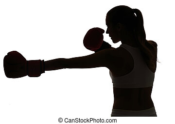 one caucasian woman boxing exercising in silhouette studio isolated