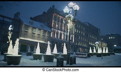 snow fall in old montreal - 4k video of a snow fall at night...