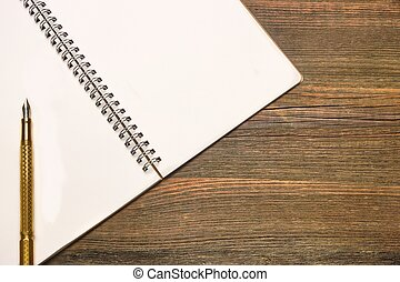 Notebook With Blank Page And Golden Pen On Wood Table -...