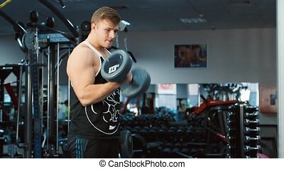 The athlete trains muscles biceps