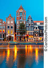 Night city view of Amsterdam canal Herengracht with typical...