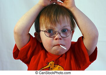 Boy with Downs Syndrome - Little Boy with Downs Syndrome and...